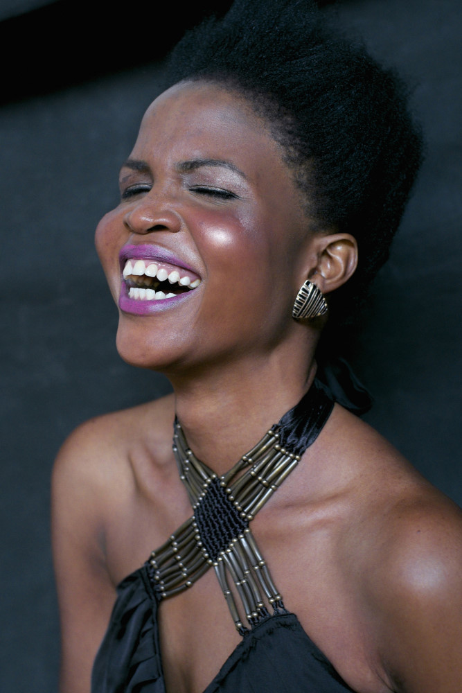 African Australian model, laughing. Modelling Portfolio headshots for Fashion, Fitness, Beauty for womwn and men.